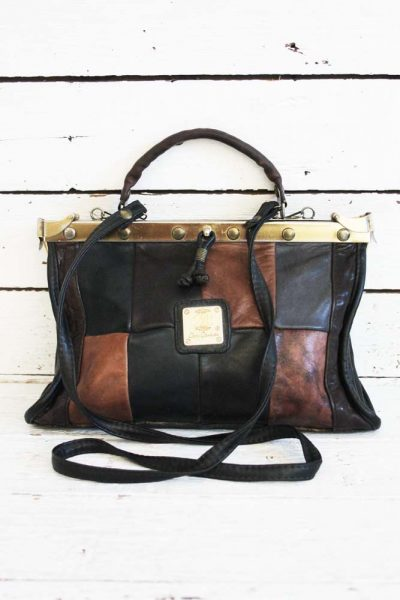 Stoere vintage patch tas.
